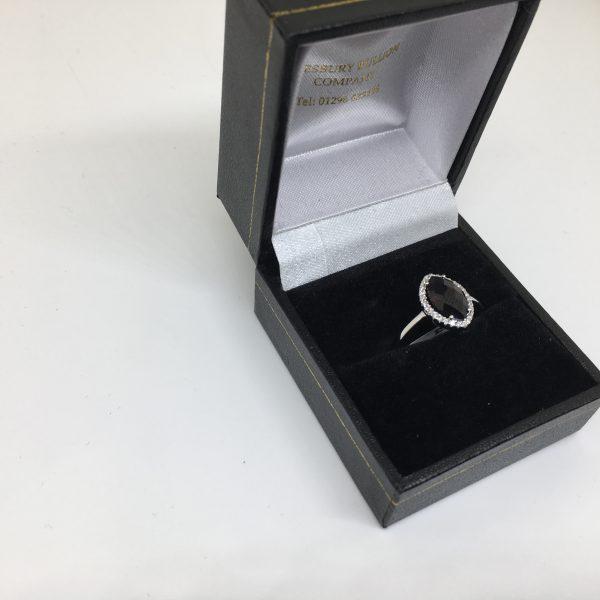 18 carat white gold garnet and diamond ring