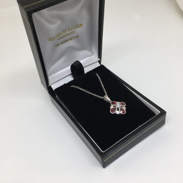 18 carat white gold ruby and diamond pendant and chain