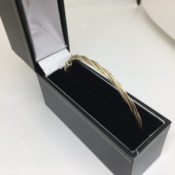 Preowned 9 carat yellow gold twisted bangle