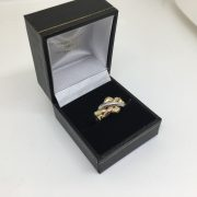 9 carat yellow, white and rose gold puzzle ring