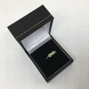 Preowned 9 carat yellow gold peridot and diamond ring