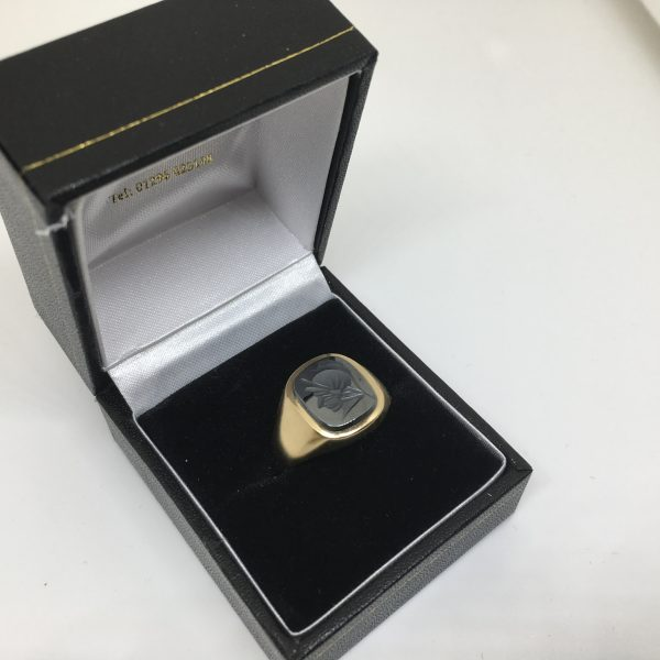 Preowned 9 carat yellow gold carved hematite signet ring