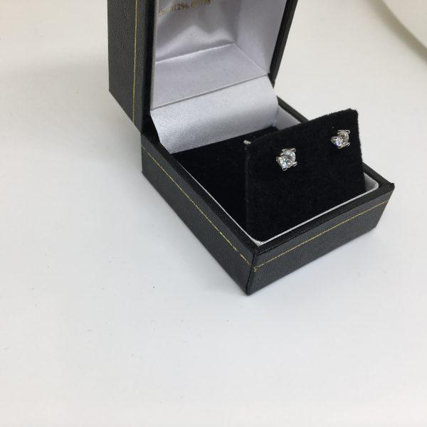 Platinum single stone diamond stud earrings