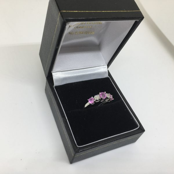 Preowned 14 carat pink sapphire and diamond ring