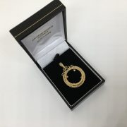 9 carat yellow gold engraved 1/2 sovereign mount pendant