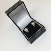 Preowned 14 carat yellow gold pearl and diamond stud earrings