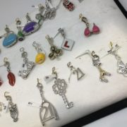 Selection of enamelled silver charms