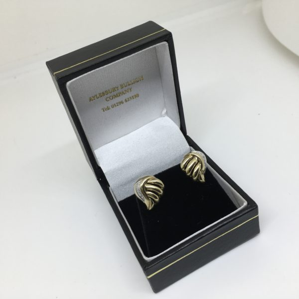 Preowned 9 carat yellow gold diamond set stud earrings