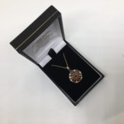 Preowned 9 carat yellow gold garnet and diamond pendant and chain