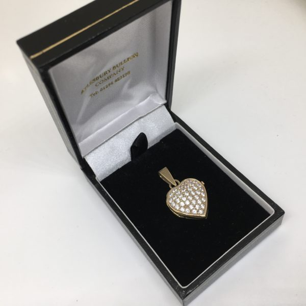 Preowned 9 carat yellow gold CZ set heart locket
