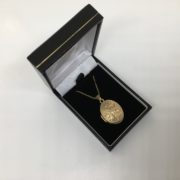 Preowned 9 carat yellow gold oval locket and chain