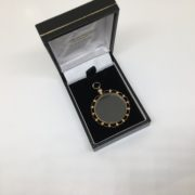 Preowned 9 carat yellow gold open faced locket