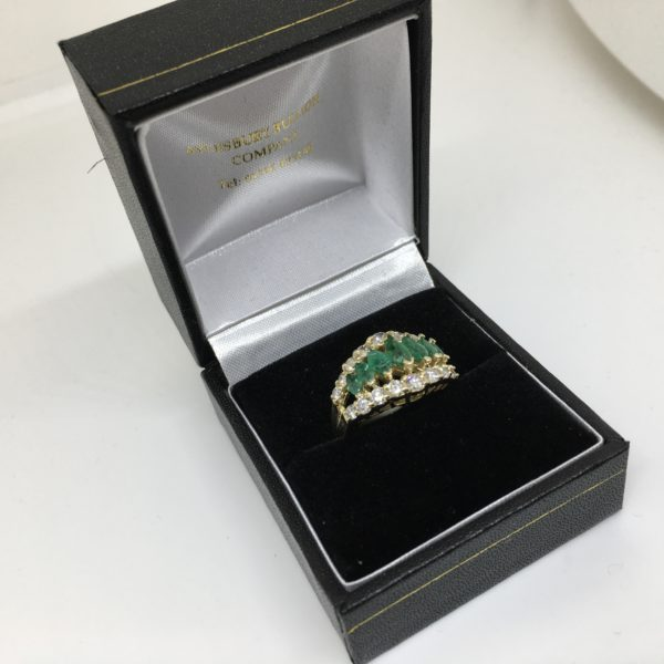 Preowned 14 carat yellow gold emerald and diamond ring