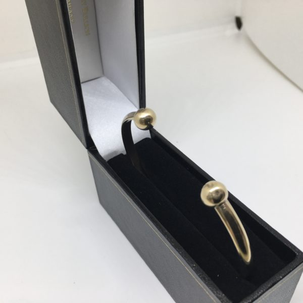 Preowned 9 carat yellow gold torque bangle