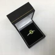 18 carat white gold peridot and diamond ring