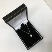 Preowned 9 carat white gold diamond earring, pendant and chain set