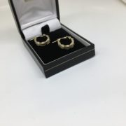 9 carat yellow gold textured oval hoop earrings