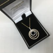 18 carat yellow, rose and white gold diamond pendant and chain
