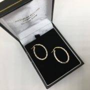 9 carat yellow and white gold twisted oval hoop earrings