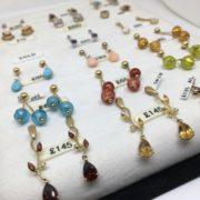 Gold gem stone set earring selection
