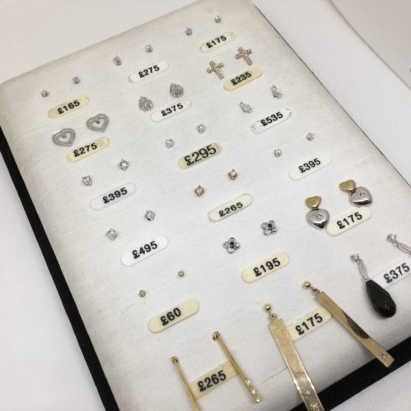 Selection of diamond set stud and drop earrings