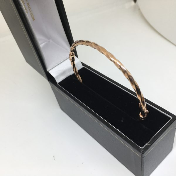 Preowned 9 carat rose gold hinged twist bangle