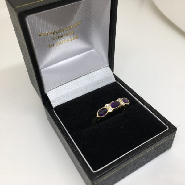 Preowned 18 carat yellow gold amethyst and diamond ring