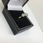 Preowned 18 carat yellow gold diamond three stone ring