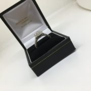Preowned 14 carat white gold diamond ring