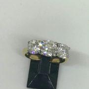 Preowned 18 carat yellow gold diamond three stone ring