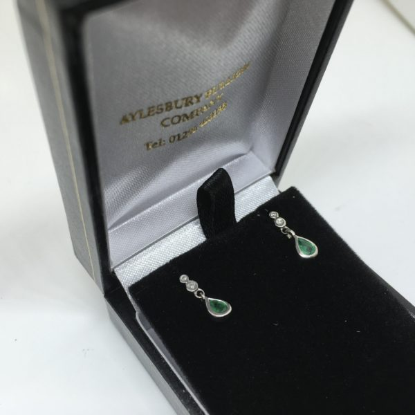 Preowned 9 carat white gold emerald and diamond drop earrings