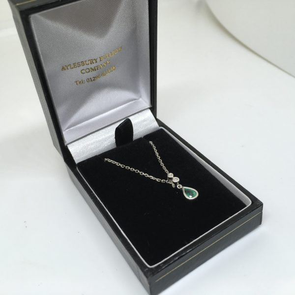 Preowned 9 carat white gold emerald and diamond pendant and chain