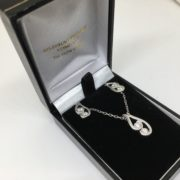 18 carat white gold diamond pendant, chain and earring set