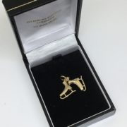 Preowned 9 carat yellow gold ice skate charm/ pendant