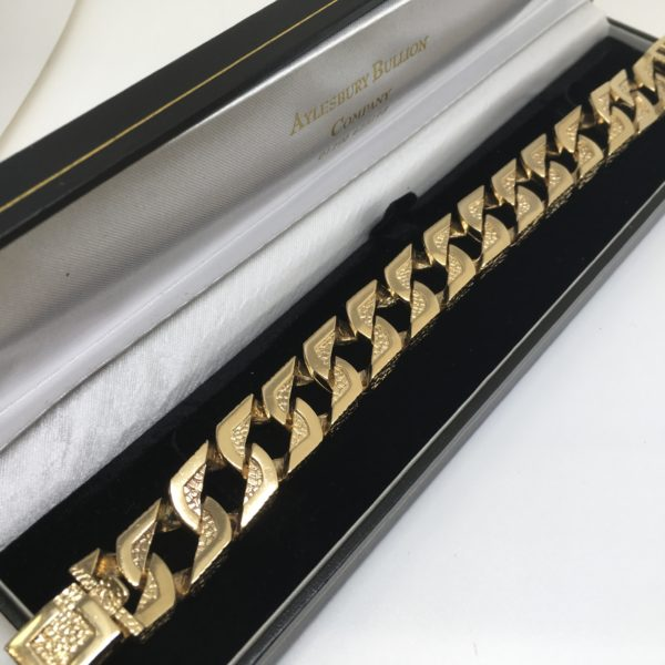 Preowned 9 carat yellow gold barked curb bracelet