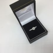 Platinum diamond single stone ring with diamond set shoulders