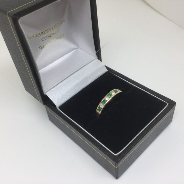 9 carat yellow gold emerald and diamond band/ eternity ring