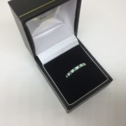 18 carat white gold emerald and diamond band/ eternity ring