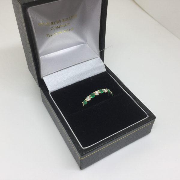 18 carat yellow gold emerald and diamond band/ eternity ring