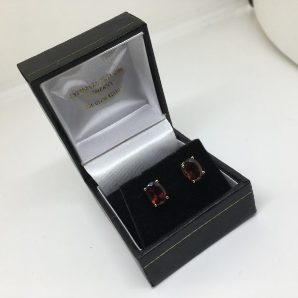 9 carat yellow gold single stone garnet stud earrings