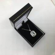9 carat white gold blue topaz and diamond pendant and chain
