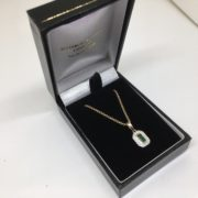9 carat yellow gold emerald and diamond pendant and chain