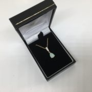9 carat yellow gold opal and diamond pendant and chain