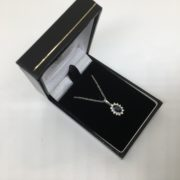 9 carat white gold sapphire and diamond pendant and chain