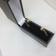Preowned 9 carat yellow gold twisted torque bangle