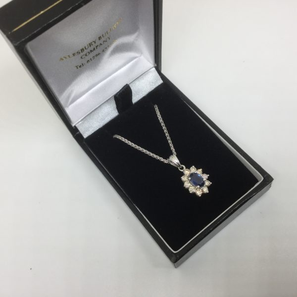 Preowned 18 carat white gold sapphire and diamond pendant and chain