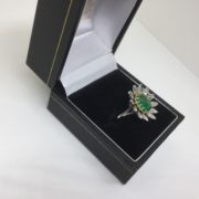 Preowned 18 carat white gold emerald and diamond ring