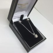 9 carat white gold single stone diamond earrings, pendant and chain set