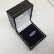 Preowned 18 carat yellow gold tanzanite and diamond ring