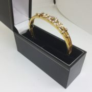 Preowned 15 carat yellow gold pearl and diamond bangle